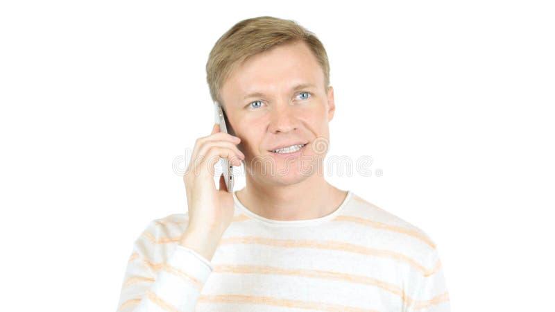 Uomo d'affari casuale Busy Talking sul telefono, fondo bianco isolato immagine stock