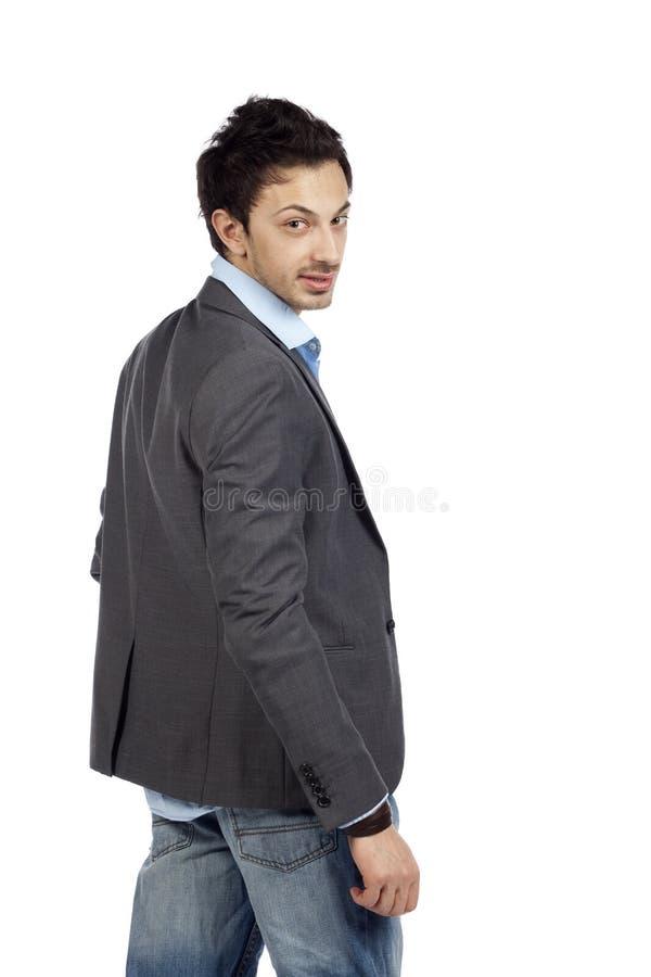 Uomo d'affari casuale che guarda indietro fotografie stock