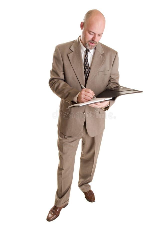 Uomo d'affari - catturare le note sul blocchetto per appunti fotografie stock libere da diritti
