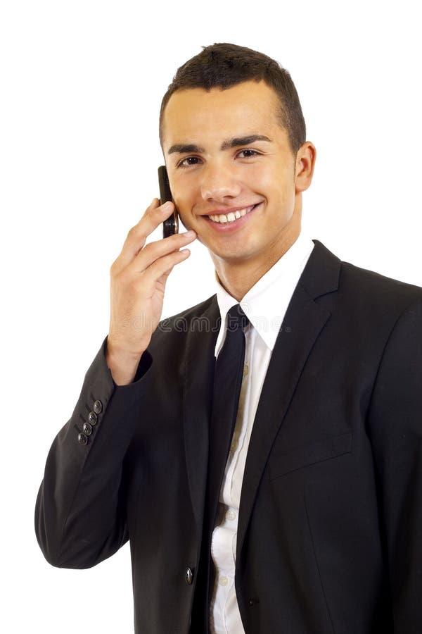 Uomo d'affari che comunica sul mobile fotografia stock libera da diritti