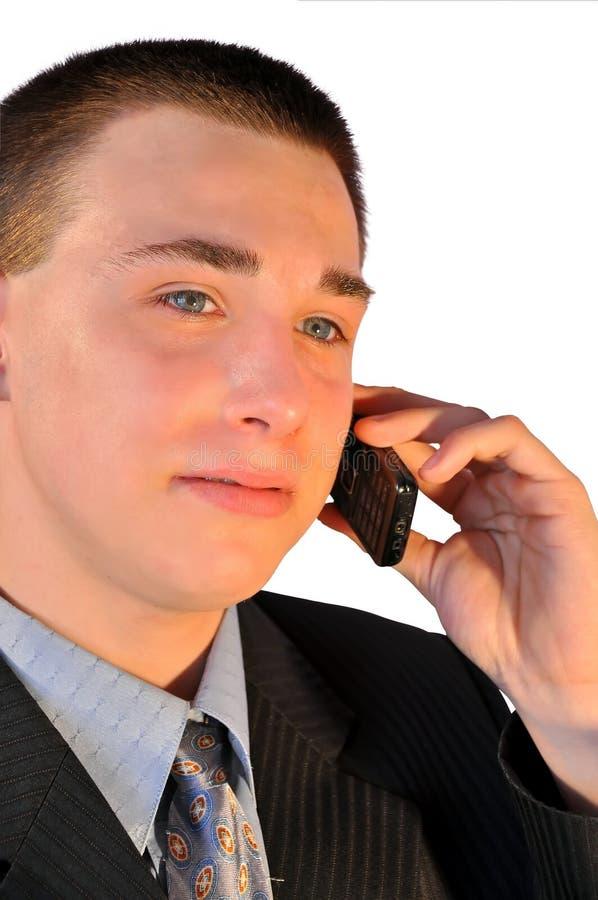 Uomo d'affari che comunica sul telefono fotografie stock