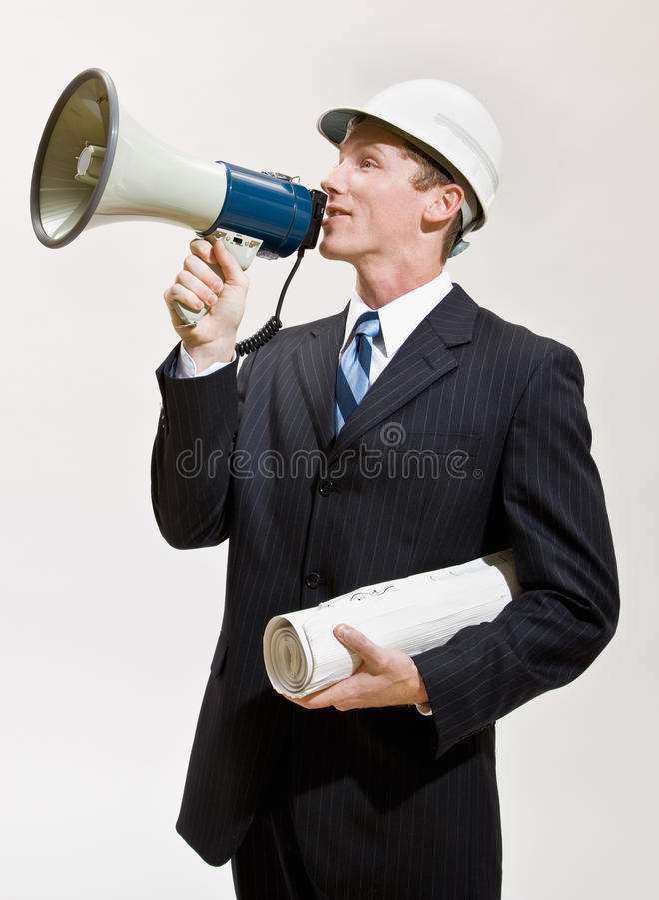 Uomo d'affari che comunica tramite il megafono immagine stock