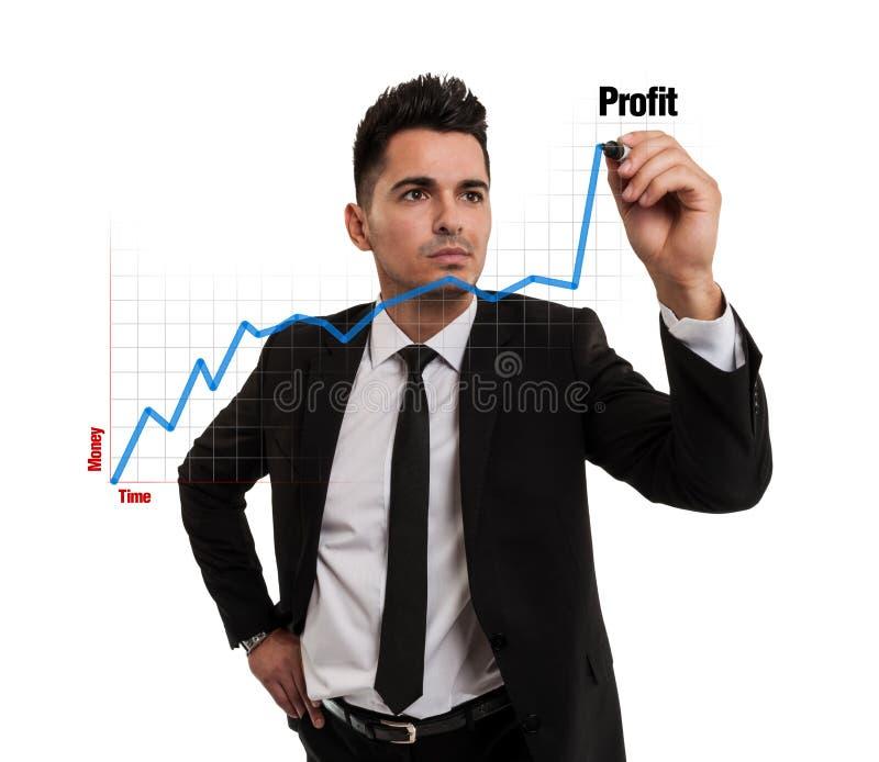 Uomo d'affari che crea un diagramma finanziario fotografia stock