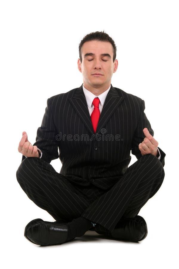 Uomo d'affari che fa yoga fotografia stock libera da diritti