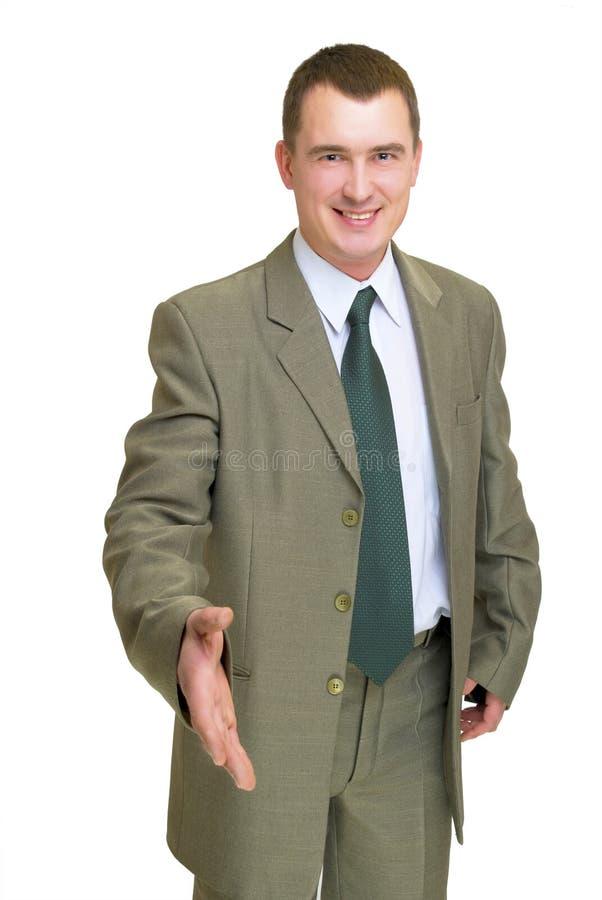 Uomo d'affari che gesturing ciao fotografia stock libera da diritti