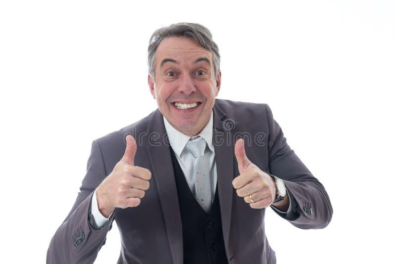 Uomo d'affari che gesturing positivamente Dirigente in vestito sul BAC bianco immagine stock libera da diritti