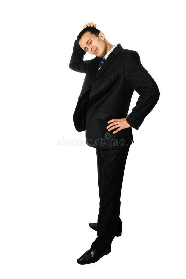 Uomo d'affari che graffia la sua testa, confusa fotografie stock libere da diritti