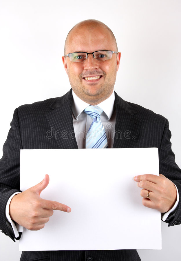 Uomo d'affari che indica allo spazio in bianco immagine stock