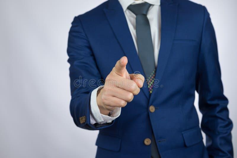 Uomo d'affari che indica il dito indice immagine stock