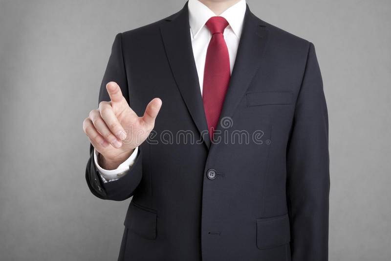 Uomo d'affari che indica o che tocca qualcosa fotografia stock