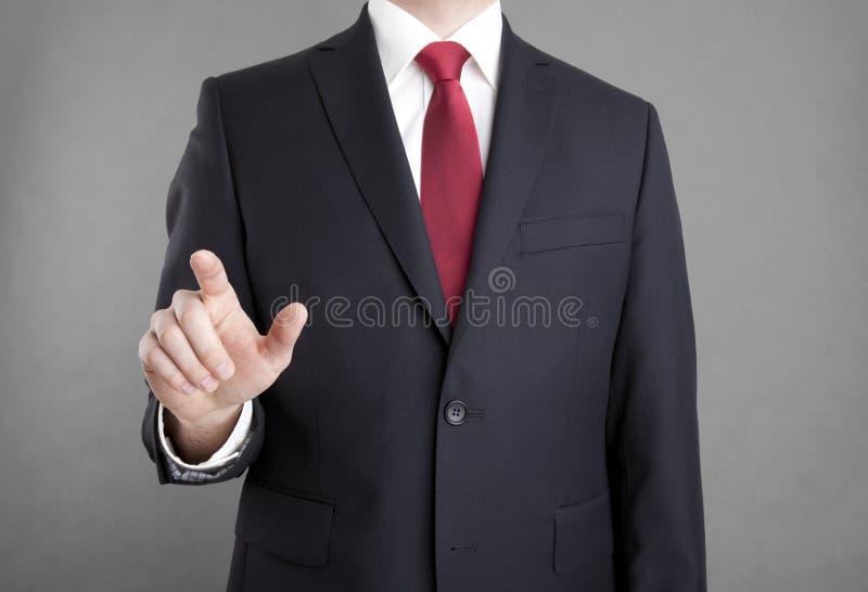 Uomo d'affari che indica o che tocca qualcosa fotografie stock