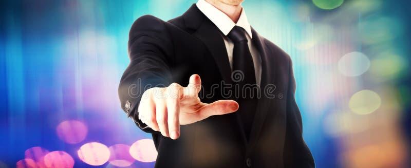 uomo d'affari che indica qualcosa immagini stock