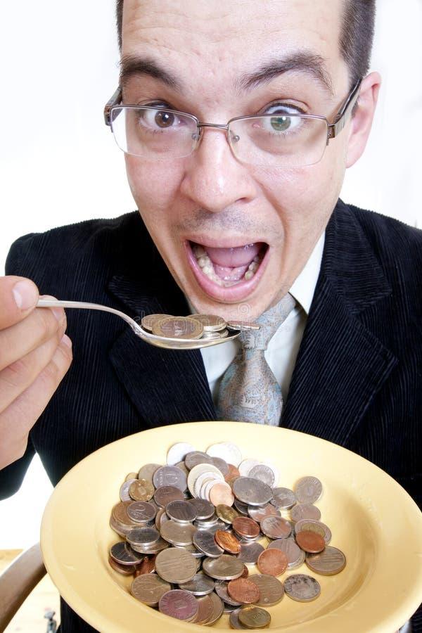Uomo d'affari che mangia soldi