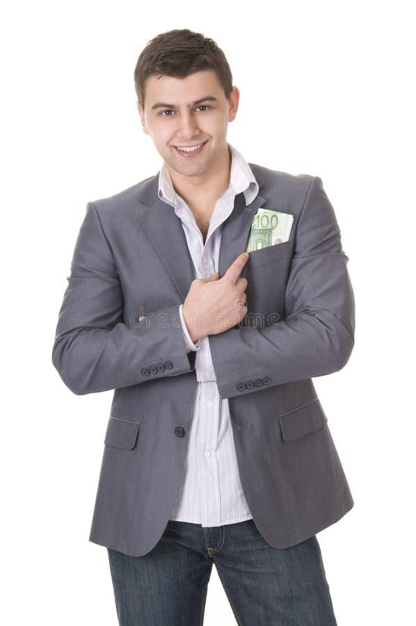 Uomo d'affari che mette soldi nella casella fotografia stock