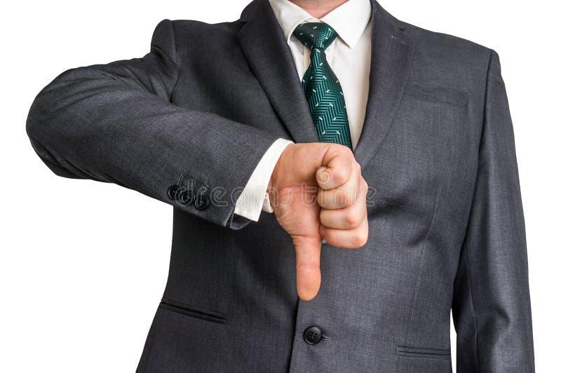 Uomo d'affari che mostra gesto con il pollice giù fotografie stock