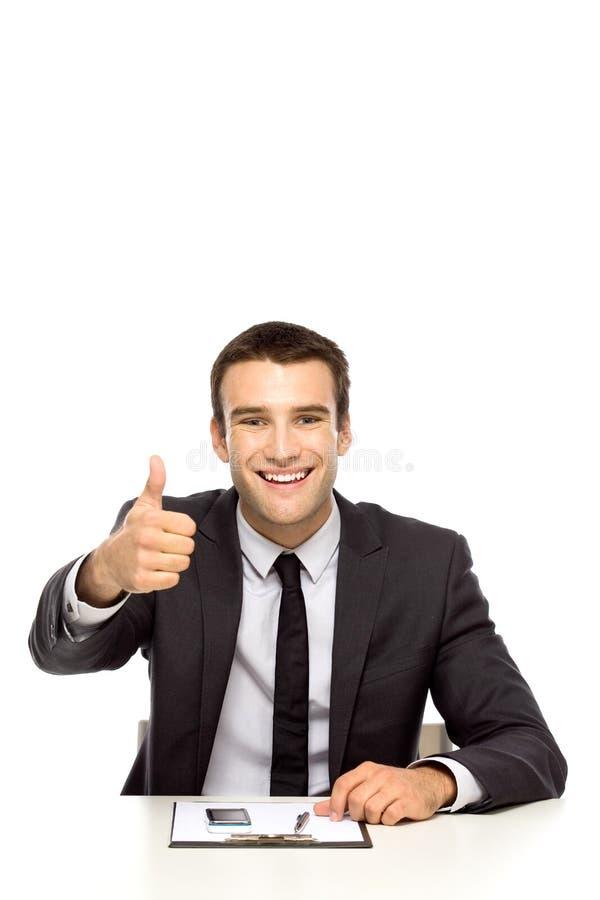 Uomo d'affari che mostra i pollici in su fotografie stock libere da diritti