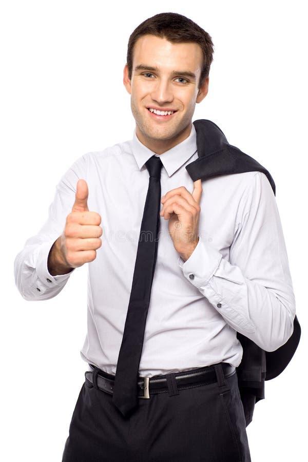 Uomo d'affari che mostra i pollici in su fotografia stock libera da diritti