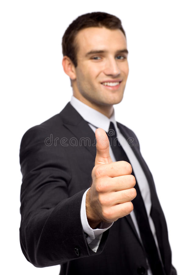 Uomo d'affari che mostra i pollici in su immagine stock