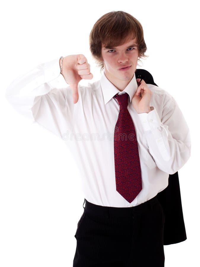 Uomo d'affari che mostra il suo pollice giù fotografia stock libera da diritti