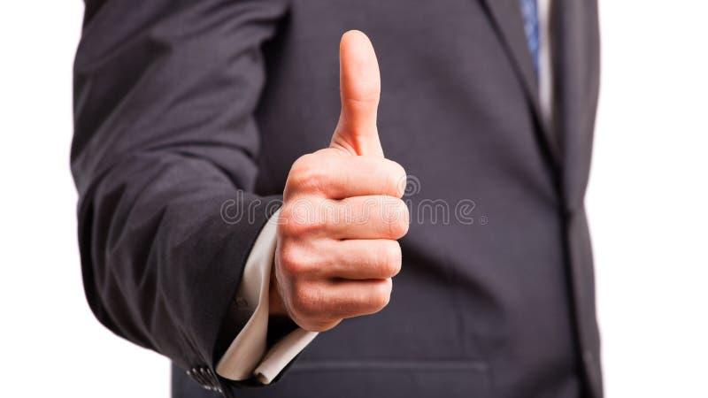 Uomo d'affari che mostra pollice sul segno immagine stock