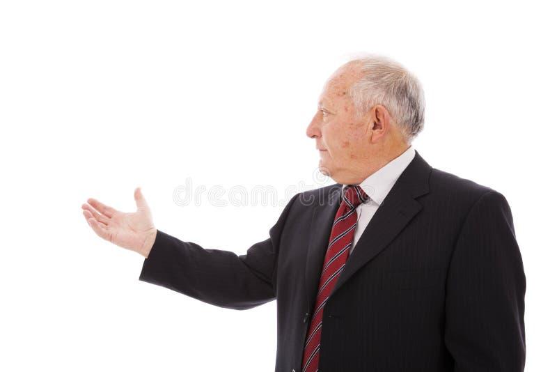 Uomo d'affari che mostra qualcosa immagini stock