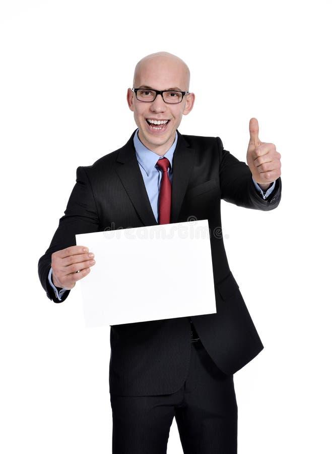 Uomo d'affari che mostra segno in bianco fotografia stock libera da diritti