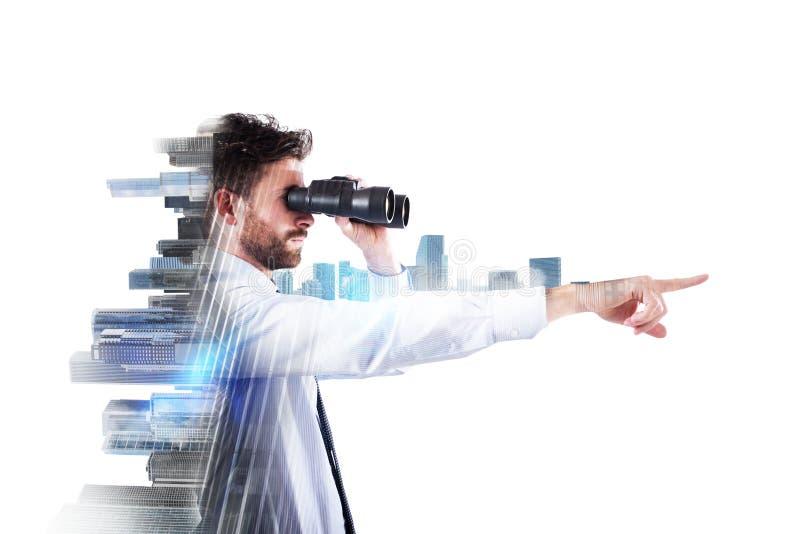 Uomo d'affari che osserva al futuro fotografia stock