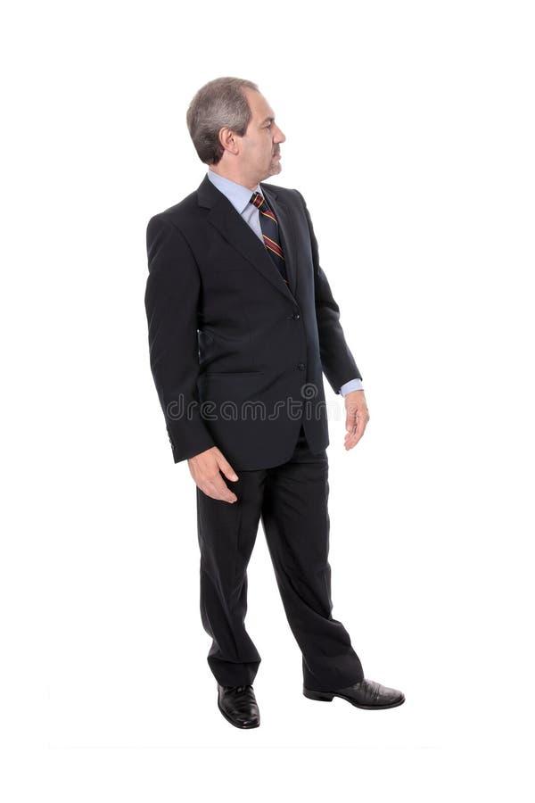 Uomo d'affari che osserva a sinistra immagine stock libera da diritti