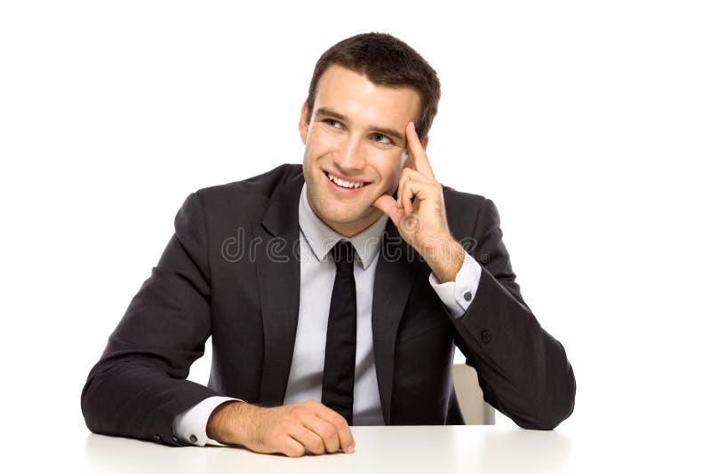 Uomo d'affari che osserva in su fotografia stock