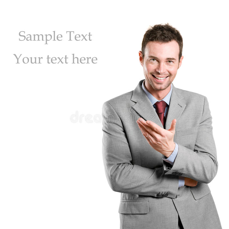Uomo d'affari che presenta il vostro testo fotografia stock