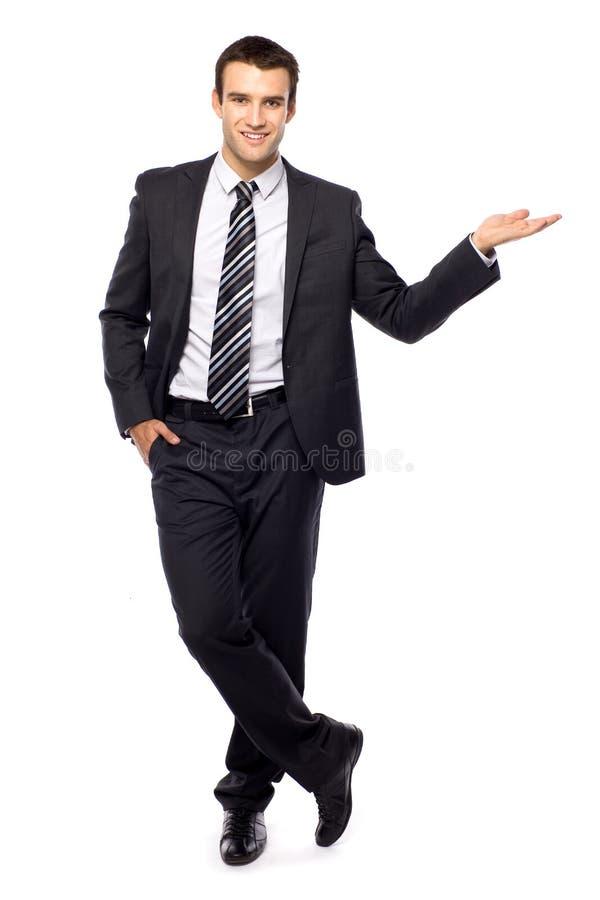 Uomo d'affari che presenta qualcosa immagini stock
