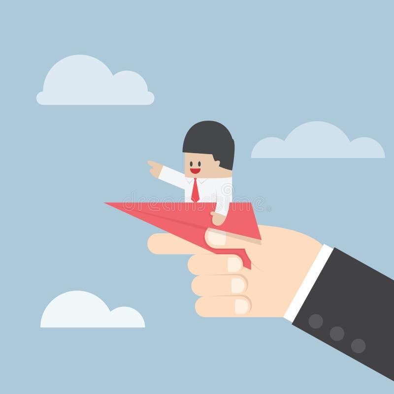 Uomo d'affari che si siede sull'aereo di carta con la grande mano pronta a gettare illustrazione di stock