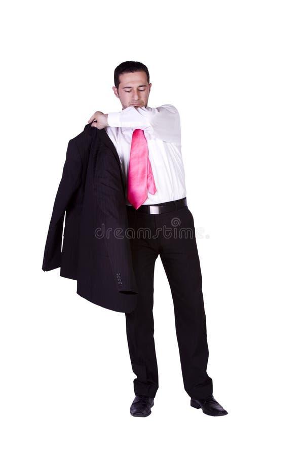 Uomo d'affari che si veste in su fotografia stock