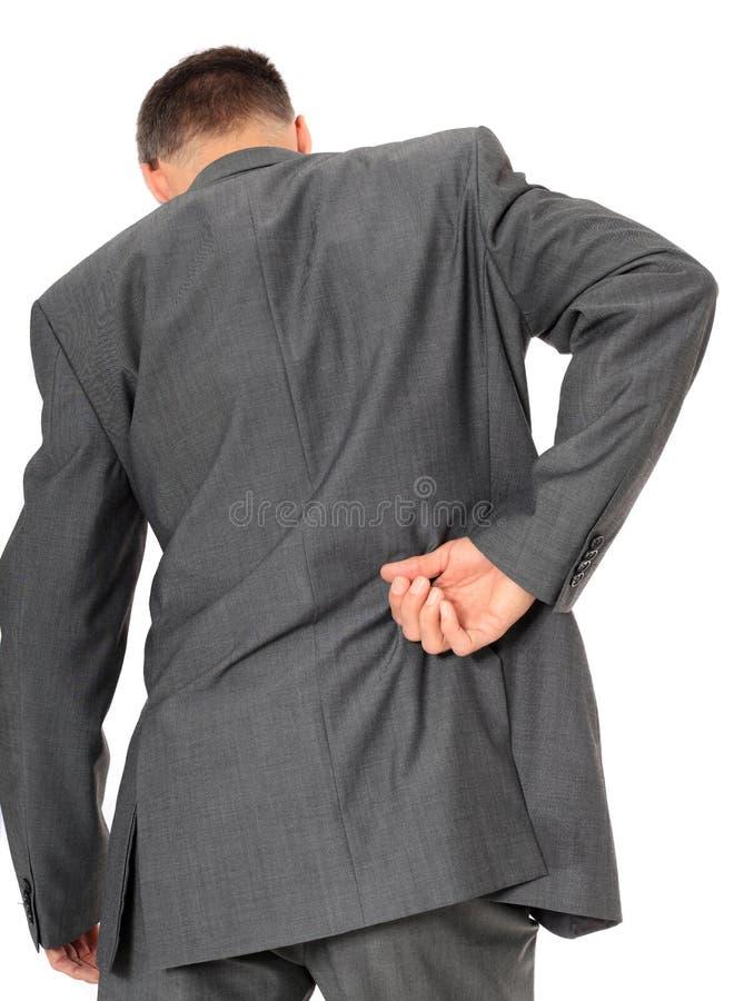 Uomo d'affari che soffre dal mal di schiena fotografie stock