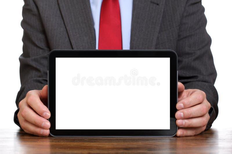 Uomo d'affari che tiene ridurre in pani digitale in bianco immagini stock