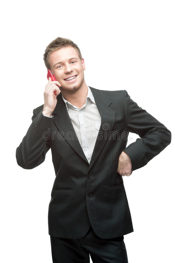 Uomo d'affari che tiene telefono cellulare rosa fotografia stock