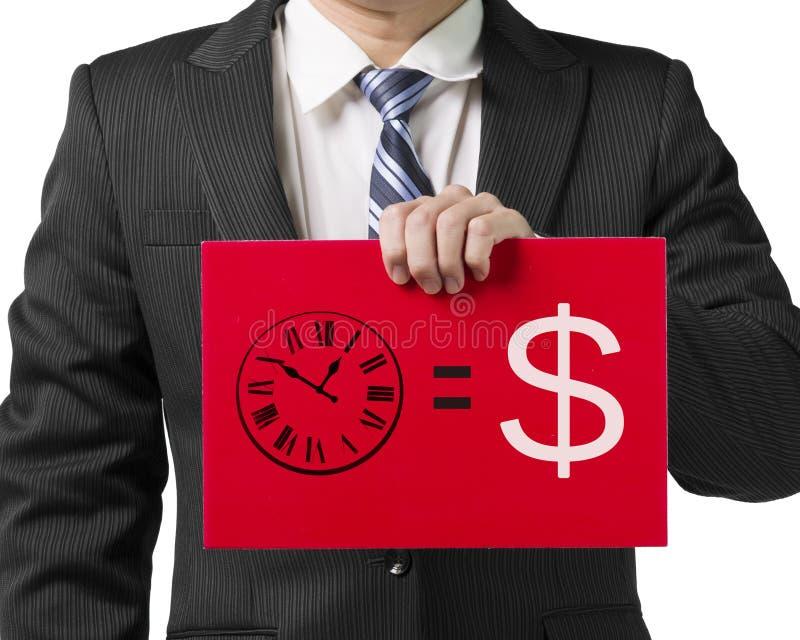 Uomo d'affari che tiene un bordo rosso con il disegno Il tempo è denaro del concetto fotografie stock libere da diritti