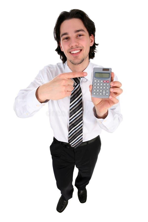 Uomo d'affari che tiene un calcolatore fotografia stock libera da diritti