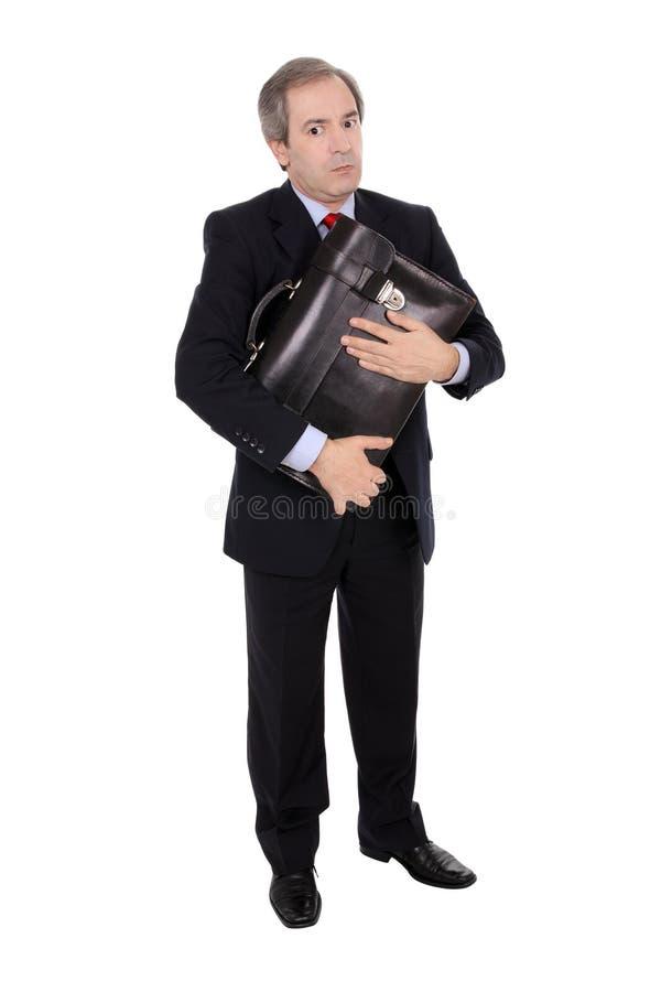 Uomo d'affari che tiene una cartella fotografie stock