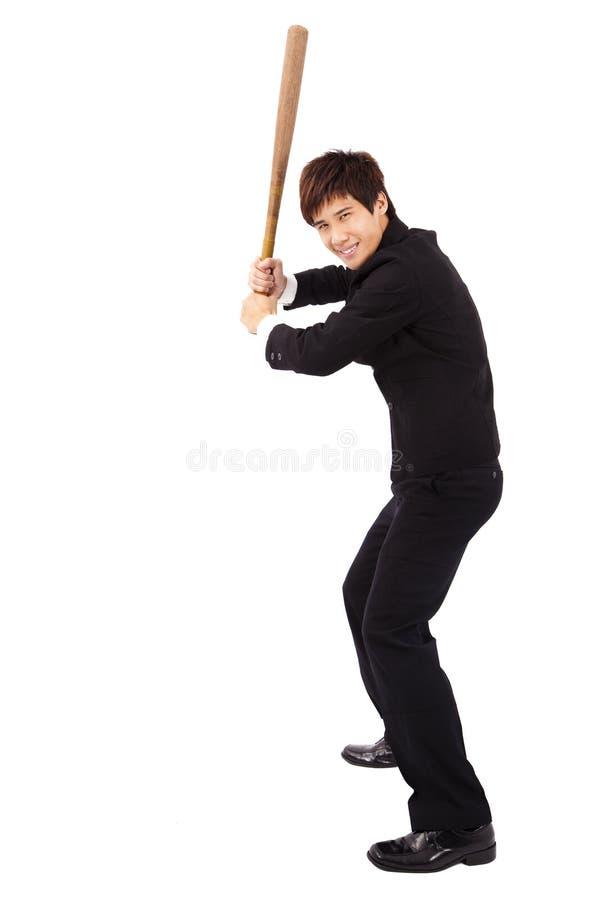 Uomo d'affari che tiene una mazza da baseball fotografie stock libere da diritti