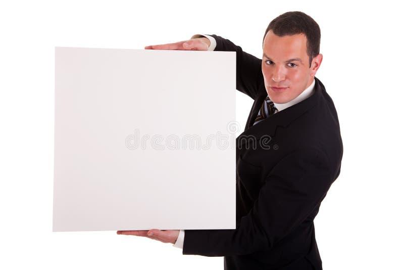 Uomo d'affari che tiene una scheda bianca immagini stock libere da diritti