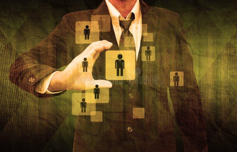 Uomo d'affari Choosing la persona giusta nella vecchia carta immagine stock
