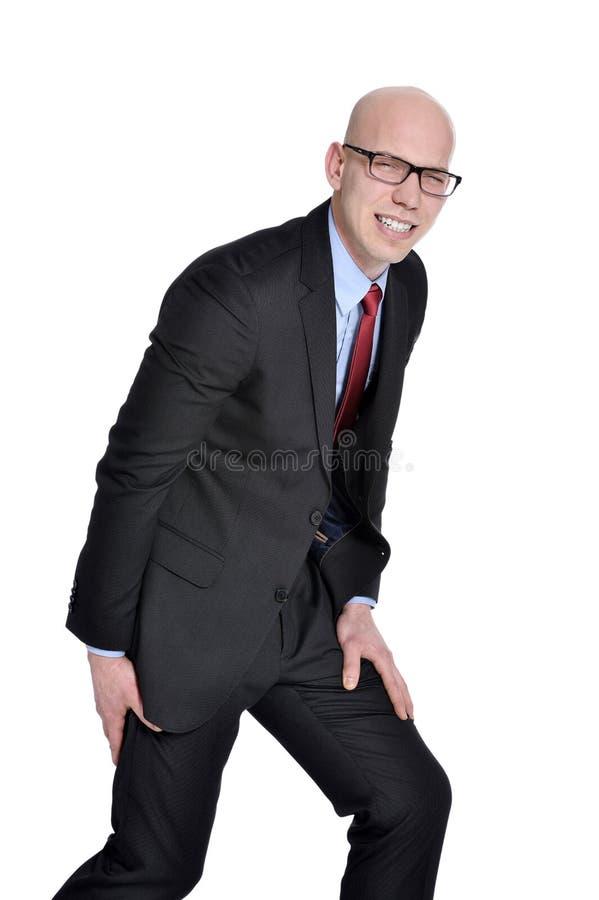 Uomo d'affari con dolore o i crampi di gamba fotografie stock libere da diritti