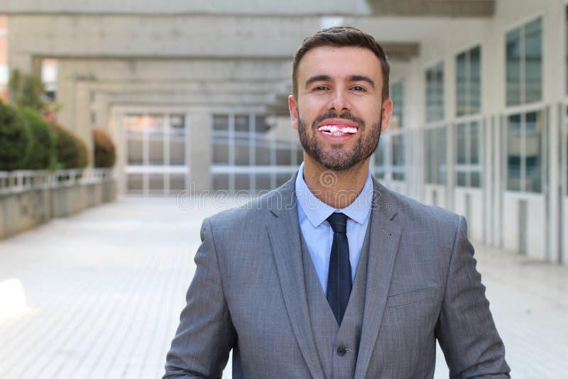 Uomo d'affari con i denti realmente cattivi immagini stock libere da diritti