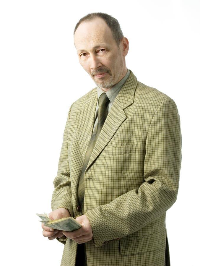 Uomo d'affari con i dollari immagini stock libere da diritti