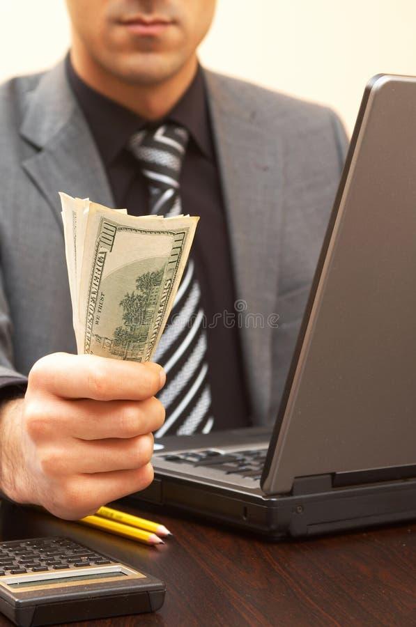 Uomo d'affari con i dollari fotografia stock