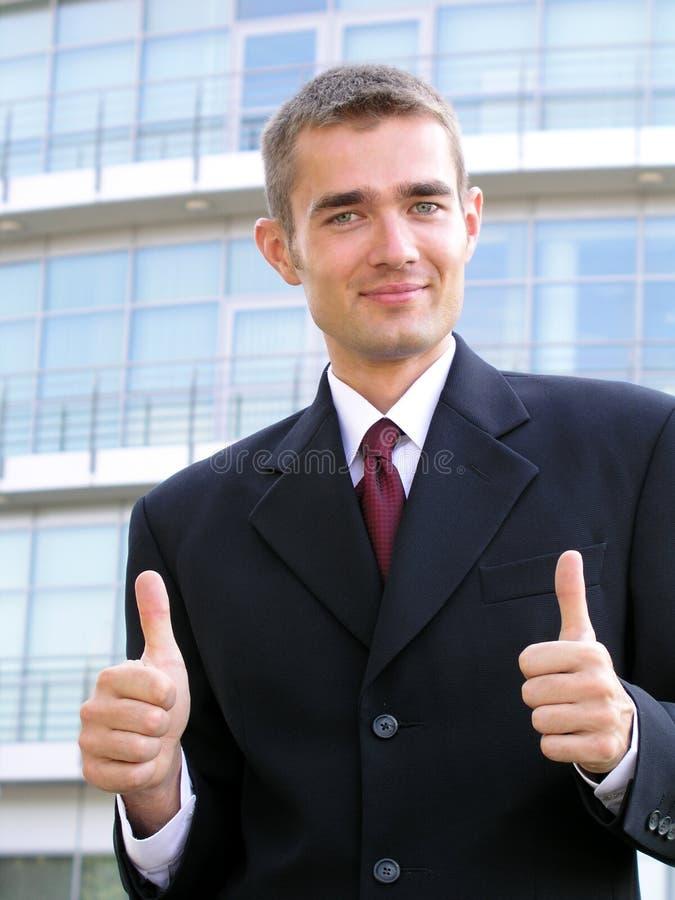 Uomo d'affari con i pollici in su fotografia stock