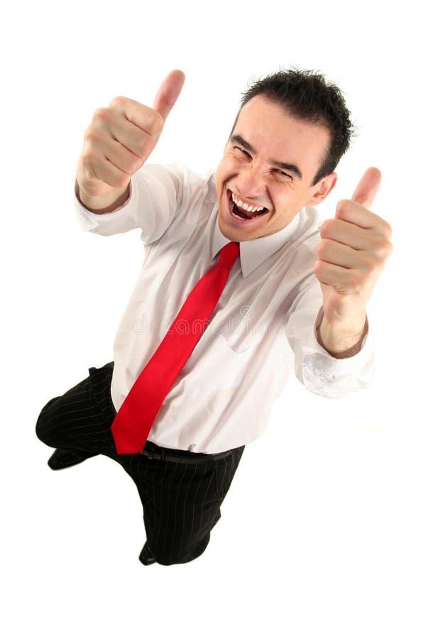 Uomo d'affari con i pollici in su immagine stock