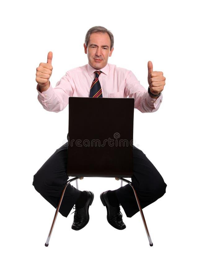 Uomo d'affari con i pollici in su fotografie stock libere da diritti