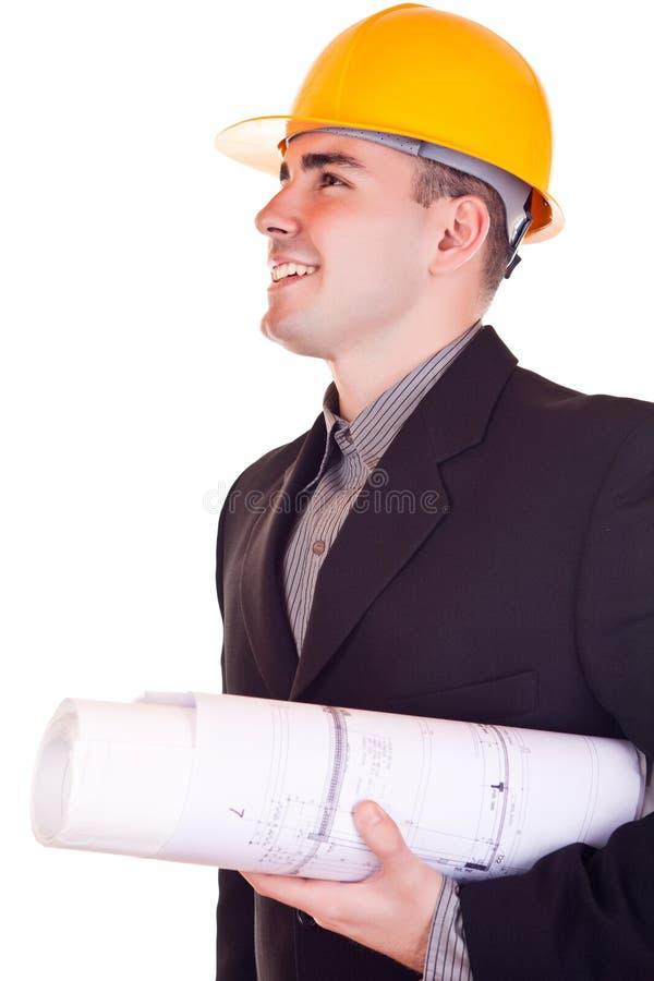 Uomo d'affari con il casco che osserva in su immagini stock libere da diritti